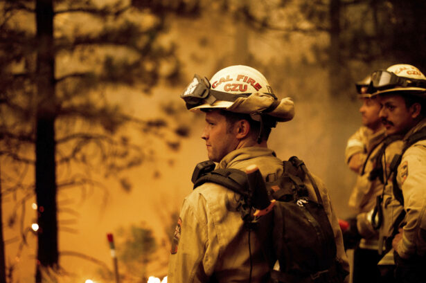 Firefighter Jesse Forbes monitors flames