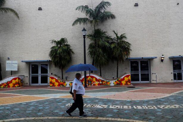 A man walks with an umbrella