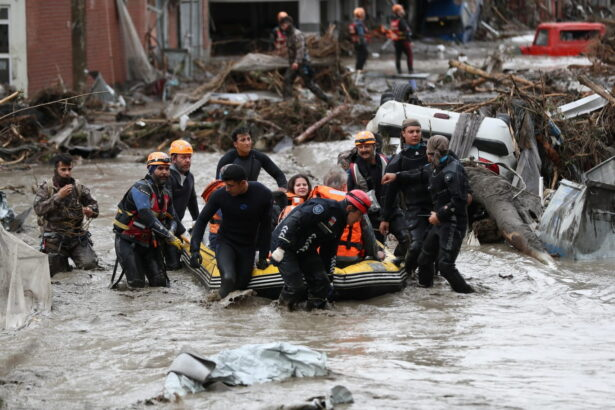 Search and Rescue team members evacuate locals
