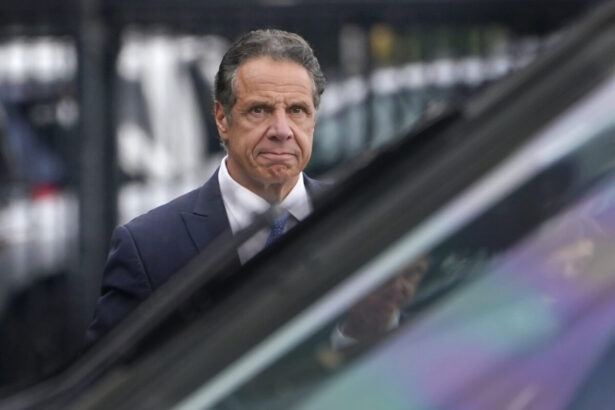 Andrew Cuomo prepares to board a helicopter