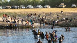 Del Rio Migrant Camp Clearing, Some Released in US