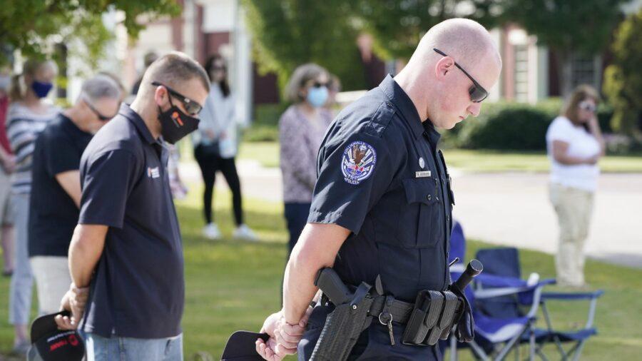Residents Seek Healing as Details Emerge in Grocery Shooting