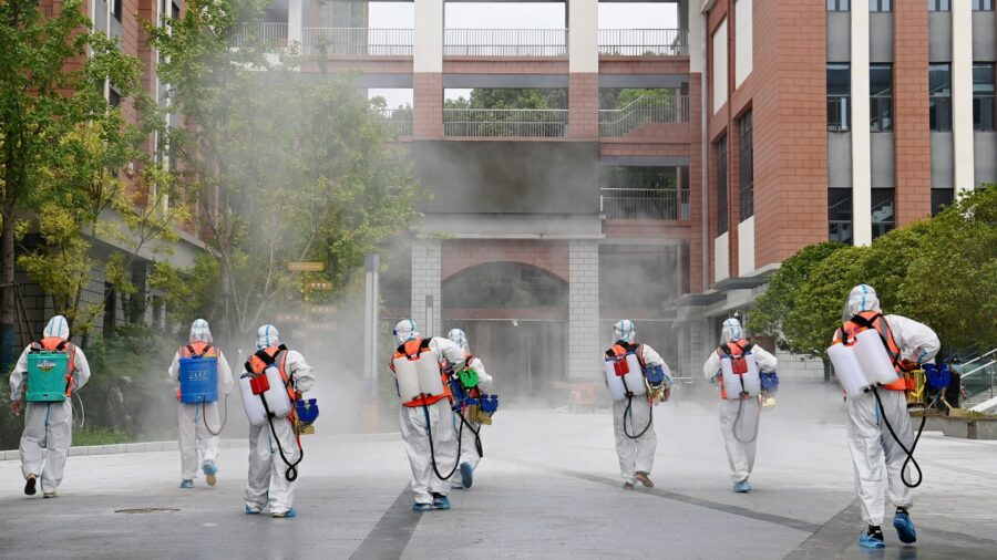 Chinese City With COVID-19 Outbreak Stops Buses, Trains