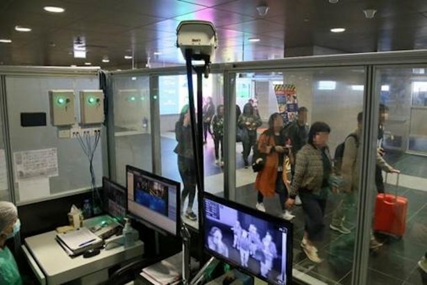 Officials monitor thermal scanners