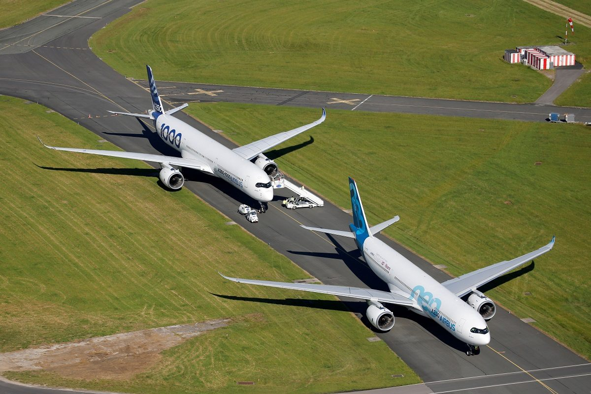 An Airbus A350-1000 and an Airbus A330 NEO are seen during the 53rd International Paris Air Show at Le Bourget Airport near Paris,