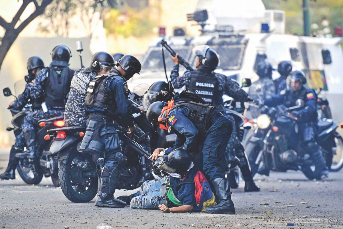 An anti-Maduro protester is detained