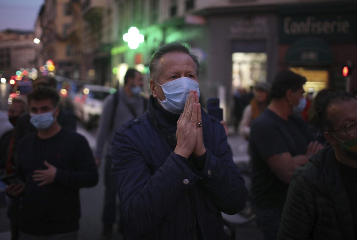 man prays in the street