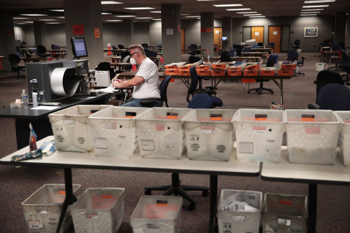 Election officials count absentee ballots