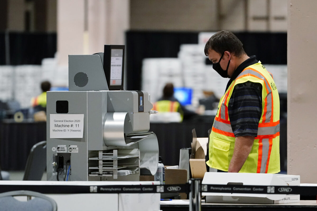 PA election worker scans ballots