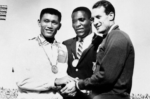 three-way handshake after receiving medals