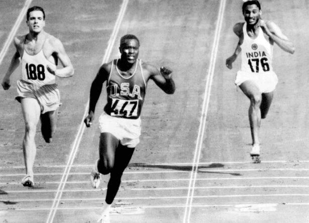 Rafer Johnson finishes the decathlon 100 meter dash