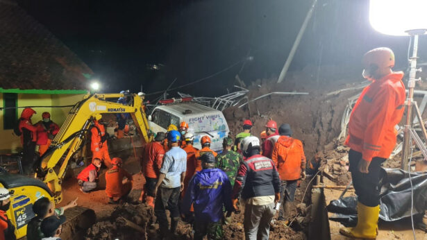 Rescuers work the scene of a landslide