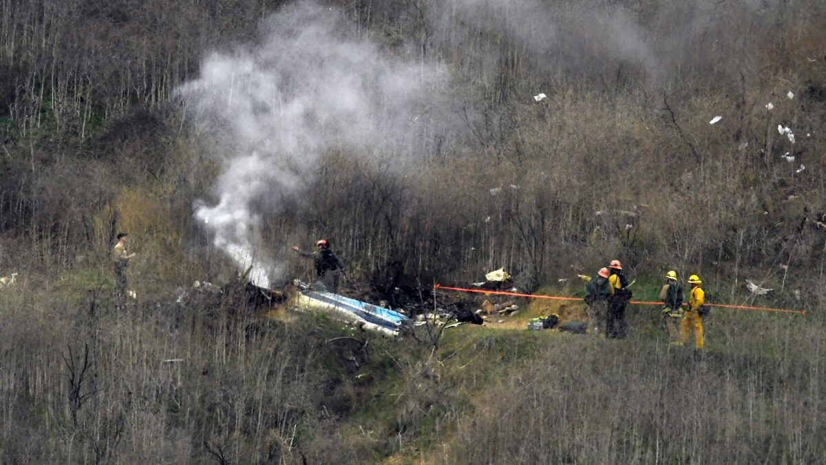 Firefighters work the crash scene