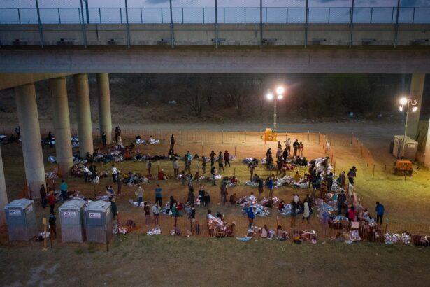 migrants-under-bridge