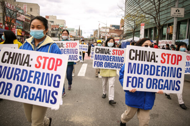 Falun Gong practitioners take part in a parade