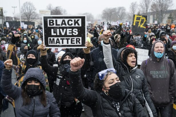 Demonstrators march to Brooklyn Center Police Department