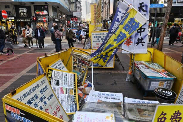 A Falun Gong information booth is vandalized