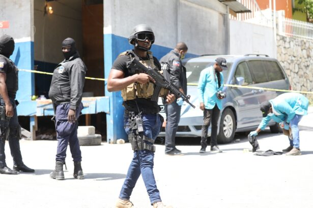Members of the Haitian police and forensics