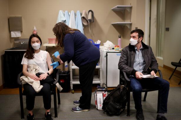 flight attendants receive COVID-19 vaccines