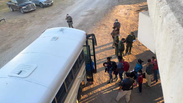 Illegal immigrants board a bus