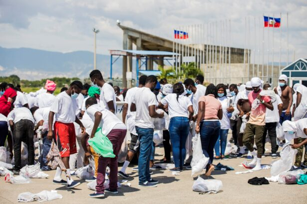Haitian nationals collect their belongings